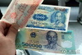 组图:在越南 50万元大钞能买啥玩艺儿?