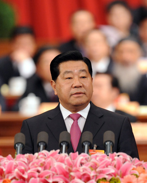 贾庆林作全国政协常委会工作报告。 新华社记者丁林摄