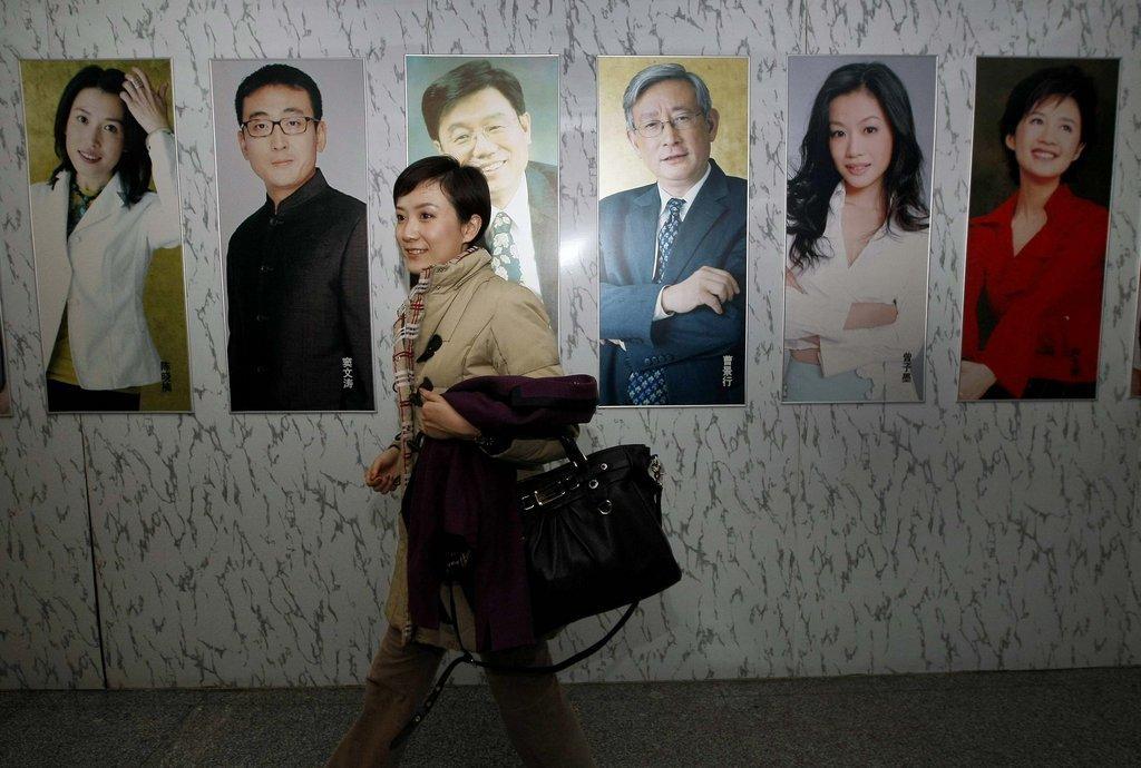 3月14日早晨,秦枫5点钟便起床了,她要去参加温总理的中外记者见面会。