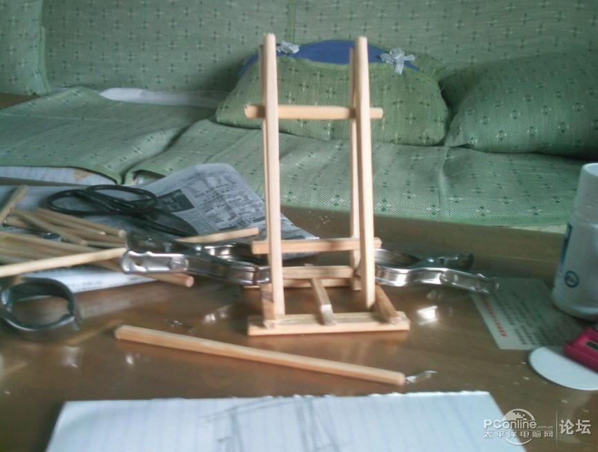 牛人用吃饭筷子制作魅族m8手机支架