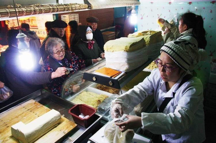 大学生卖豆腐 靠着自己的打拼,现在的生意已经很不错了