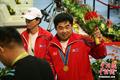 朝鲜力士夺冠同胞沾喜气