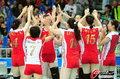 高清:中韩女排亚运决战 中国队赛前鼓劲热身