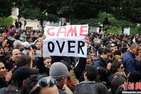 组图:突尼斯冲突升级 总统弃国逃亡