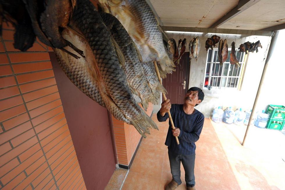 【中国人的一天】鱼干里的年味儿