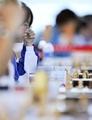 组图:大运会国际象棋比赛 中国选手冥思苦想