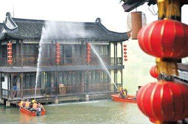 上海朱家角演练世博应急 每户都配小型灭火器