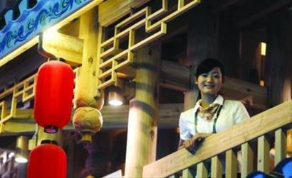 贵州馆讲解员服务世博当热身 乐衷于敲章