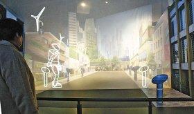 日本馆内游客可观赏机器人奏《茉莉花》(图)