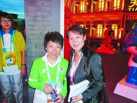 世博志愿者邓亚萍:河南馆还有我的照片呢