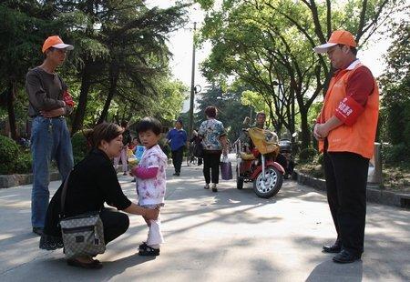 世博后上海刑案减少近半 86万志愿者保卫平安