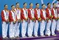 高清:中国花游队摘银自由自选 登上领奖台