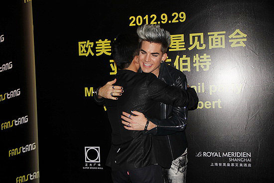 hugging boy fan