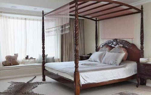 个家里最突出的非洲装饰,远处的飘窗再一次成为家人的私享茶座.-图片