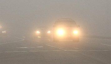雾霾天开车三步曲:减速开灯找准参照物