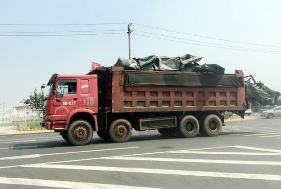 天津港车辆去向受拷 车企遭遇信任门