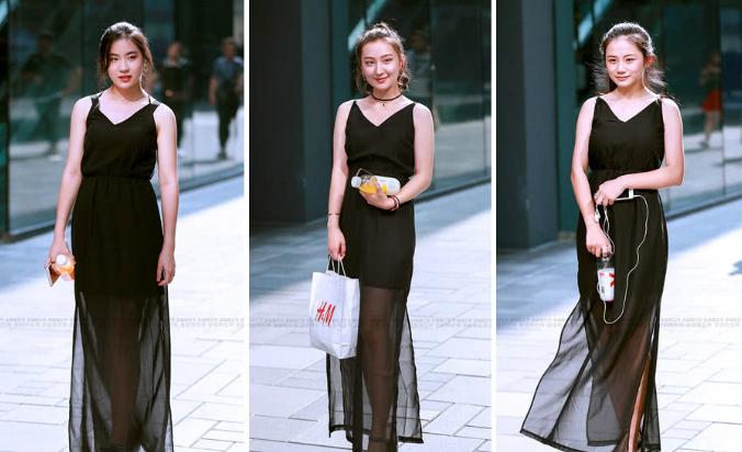 炎热的夏天很多时髦女孩都喜欢穿黑色的裙子