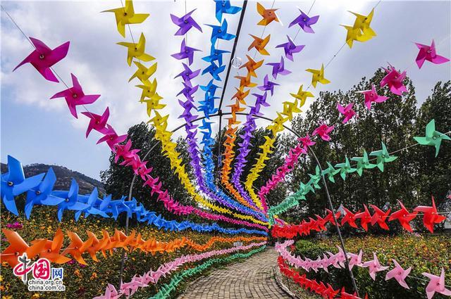 青岛西岸香博园:风车风铃伞花编织童话世界