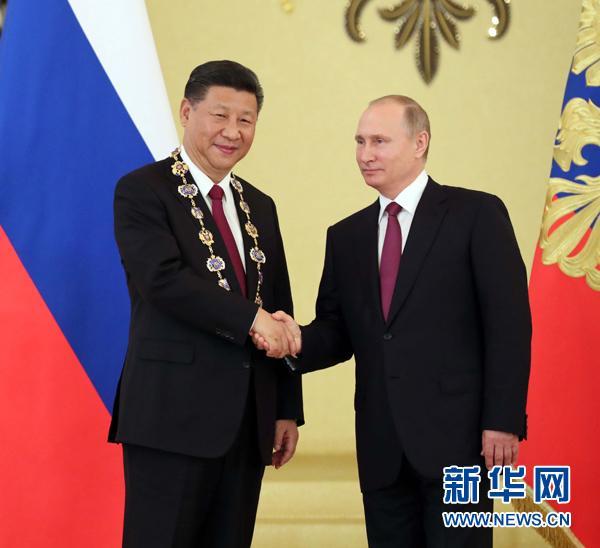 习近平同俄罗斯总统普京举行会谈 推动冬季运动交流合作