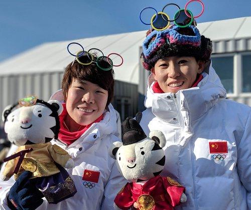 Cérémonie d'accueil de l'équipe chinoise au village olympique