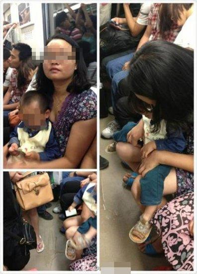 少妇地铁上当众给孩子把尿 溅 跑乘客