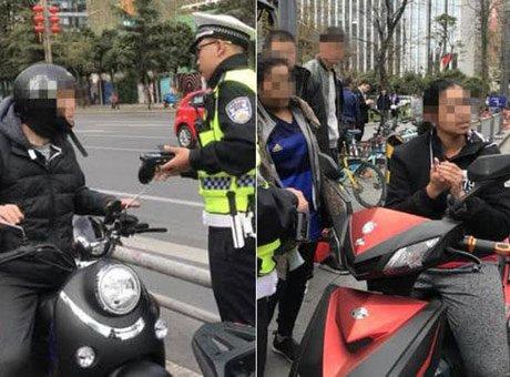 成都两外国人被罚 骑电动车不挂牌照挪用他人号牌