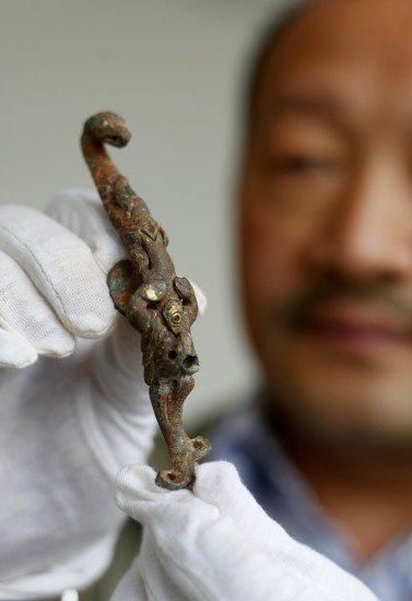 三国名将曹休墓出土 专家称难用DNA鉴定曹操墓