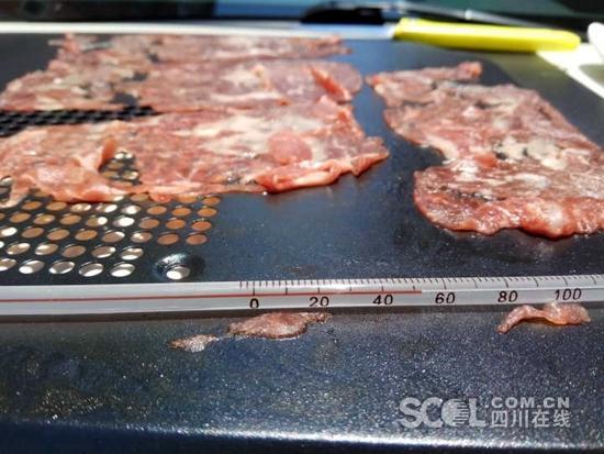 广安最高温飙至近40℃ 新鲜牛肉20分钟晒焦(图)