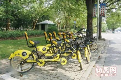 双人共享单车现身上海 警方:骑上马路系违法