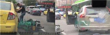 男子当街殴打女摩托司机被刑事拘留