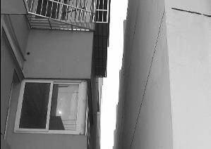 """忠县出现""""楼靠靠""""两栋楼仅距仅4厘米(图)"""