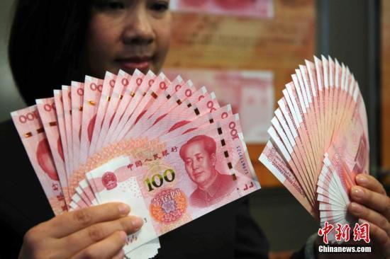人民币对美元升破6.5 去年底换2万美元现亏9000元