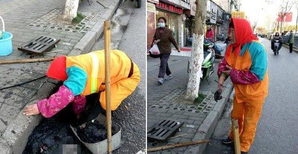 0℃的街头 环卫工用双手疏通下水道