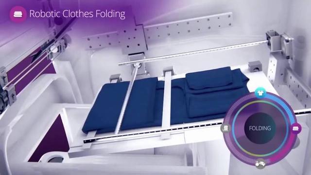 手动的将洗好的衣服夹在自动叠衣机上之后,所有剩下的事情,这款机器便