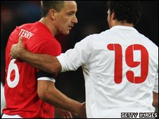 England player John Terry shaking hands with Amr Zaki of Egypt