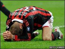 David Beckham kneeling on the pitch