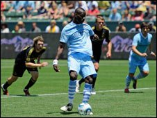 Manchester City's Mario Balotelli (in blue) takes a penalty in their match against LA Galaxy