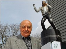 Mohammed Al Fayed below the statue of Michael Jackson, at Fulham FC