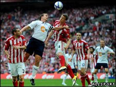 Kevin Davies (left, jumping) of Bolton Wanderers competes for the ball with Robert Huth (right, jumping) of Stoke City