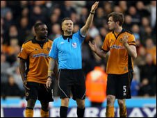 Sylvan Ebanks-Blake (L) and Richard Stearman (R) of Wolves protest to referee Mark Halsey following their team's disallowed goal