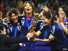 Japanese players celebrate with the World Cup