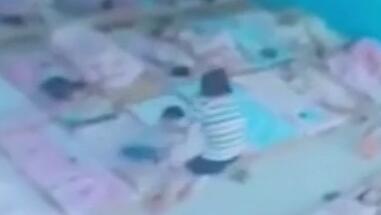 河北沧州一幼儿园教师拎起两不午睡幼儿扔地上