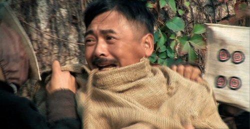 《让子弹飞》拍摄特辑 周润发被绑钢丝床遭毒打