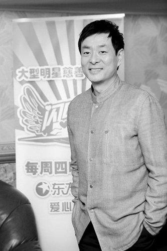 """濮存昕强调环保:今年还会骑车去""""两会""""(图)"""