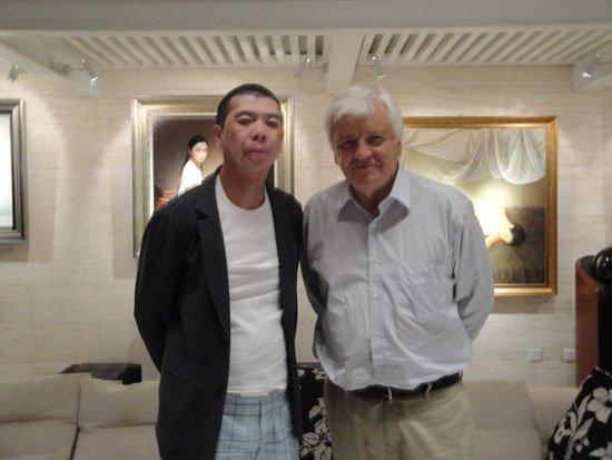 雅克·贝汉冯小刚冒雨赴会 相约中国再合作(图)