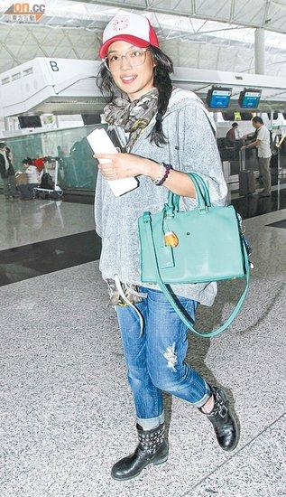 舒淇机场素颜不怕拍照 保密行踪由助理应付记者