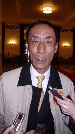 招行董事长秦晓:建议央行上半年适度加息