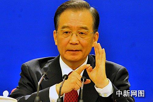 图:国务院总理温家宝回答记者提问