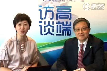 对话周文重:人民币汇率问题要由中国决定