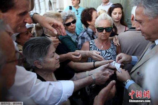 希腊与欧元区达成新拯救方案协议 潘基文表欢迎